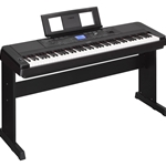 Yamaha DGX660B Black 88-key ensemble digital piano with rosewood side panels and matching stand.